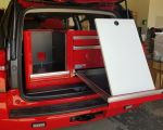 Red lightweight storage with whiteboard for SUV